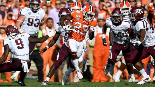 Clemson running back Lyn-J Dixon (23) breaks free against the Texas A&M defenseduring the second quarter at Memorial Stadium.