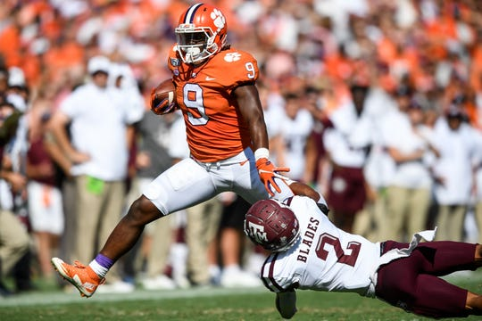 Clemson running back Travis Etienne (9) takes a hit from Texas A&M defensive back Elijah Blades (2) during the second quarter at Memorial Stadium in Clemson, S.C., Saturday, Sept. 7, 2019.