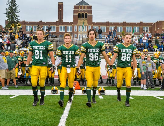 CMR football team captains from left: David Geisen, Bryce Nelson, Harrison Goss and Keegan Barnes walk to midfield for the coin toss before Friday's game against Butte.