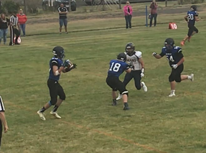 Senior Bryce Birgenheier, left, takes the pitch from Ian Moline (18) and runs 22 yards for the score in the second quarter for Geraldine-Highwood. King Ragged Robe (4) of Box Elder and the Rivals' Liam Laws (54) are in on the play.