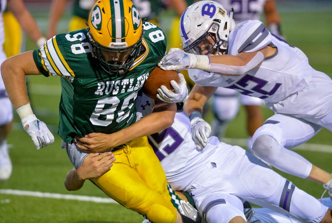 CMR's Keegan Barnes hangs on to the football during a football game against Butte earlier this month at Memorial Stadium.