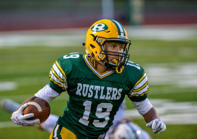CMR's Logan Richard runs with the football after making a catch in Friday's game against Butte.