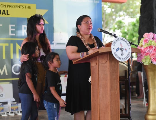 Celeste Leon Guerrero, with family members, speaks on the loss of her daughter, Jaelani Leon Guerrero, to suicide in 2016, during the Guam Nikkei Association's fifth annual Lantern Floating Ceremony at the Gov. Joseph Flores Beach Park in Tumon, Sept. 7, 2019.
