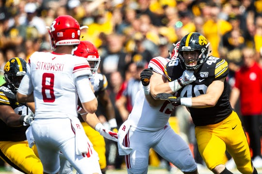 Iowa linebacker Nick Niemann (49) gets past a block during a NCAA Big Ten Conference football game against Rutgers, Saturday, Sept. 7, 2019, at Kinnick Stadium in Iowa City, Iowa.