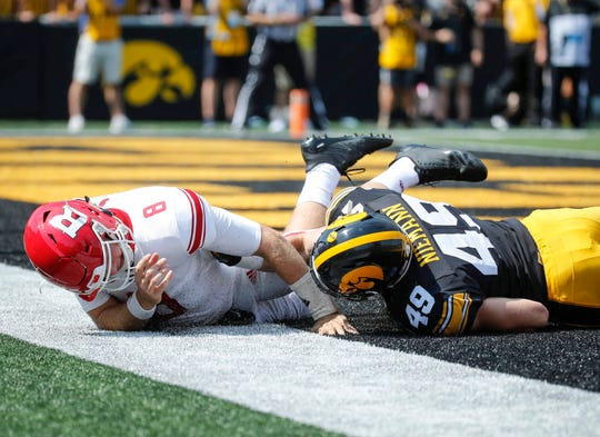 Nick Niemann was terrific as Iowa's outside linebacker in a 4-3 base defense against Rutgers. Here, he gets a quarterback hurry against Artur Sitkowski in the second half.