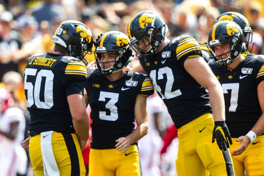 Iowa placekicker Keith Duncan (3) gets embraced by Iowa long snapper Jackson Subbert (50) and Iowa tight end Shaun Beyer (42) after a field goal during a NCAA Big Ten Conference football game against Rutgers, Saturday, Sept. 7, 2019, at Kinnick Stadium in Iowa City, Iowa.
