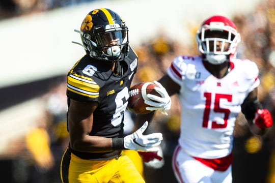 Iowa wide receiver Ihmir Smith-Marsette (6) pulls in a reception for a touchdown during a NCAA Big Ten Conference football game against Rutgers, Saturday, Sept. 7, 2019, at Kinnick Stadium in Iowa City, Iowa.