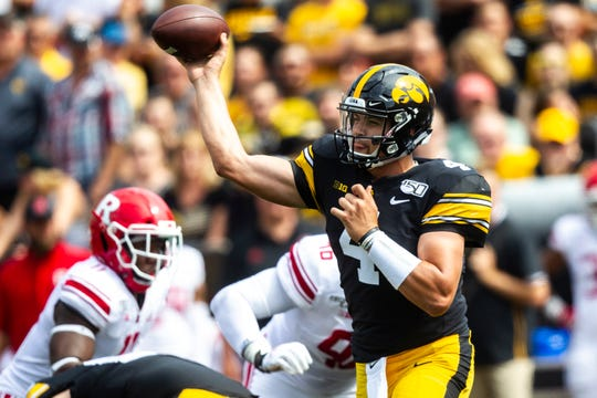 Iowa quarterback Nate Stanley (4) throws a pass during a NCAA Big Ten Conference football game against Rutgers, Saturday, Sept. 7, 2019, at Kinnick Stadium in Iowa City, Iowa.