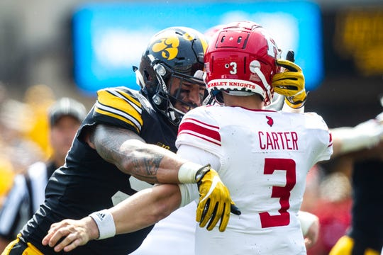 Iowa defensive end A.J. Epenesa (94) pressures Rutgers quarterback McLane Carter (3) forcing an interception during a NCAA Big Ten Conference football game against Rutgers, Saturday, Sept. 7, 2019, at Kinnick Stadium in Iowa City, Iowa.
