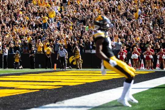Iowa Hawkeyes fans cheer as Iowa wide receiver Ihmir Smith-Marsette (6) celebrates after scoring a touchdown during a NCAA Big Ten Conference football game against Rutgers, Saturday, Sept. 7, 2019, at Kinnick Stadium in Iowa City, Iowa.