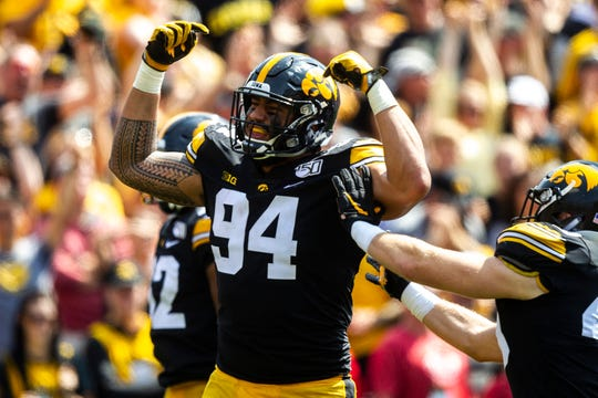 Iowa defensive end A.J. Epenesa (94) celebrates after a sack during a NCAA Big Ten Conference football game against Rutgers, Saturday, Sept. 7, 2019, at Kinnick Stadium in Iowa City, Iowa.