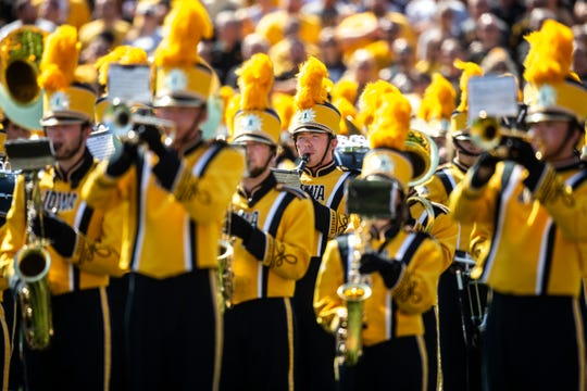 Members of the Iowa Hawkeyes marching band perform during a NCAA Big Ten Conference football game against Rutgers, Saturday, Sept. 7, 2019, at Kinnick Stadium in Iowa City, Iowa.