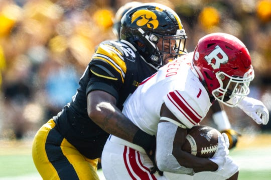 Iowa linebacker Djimon Colbert (32) tackles Rutgers running back Isaih Pacheco (1) during a NCAA Big Ten Conference football game against Rutgers, Saturday, Sept. 7, 2019, at Kinnick Stadium in Iowa City, Iowa.
