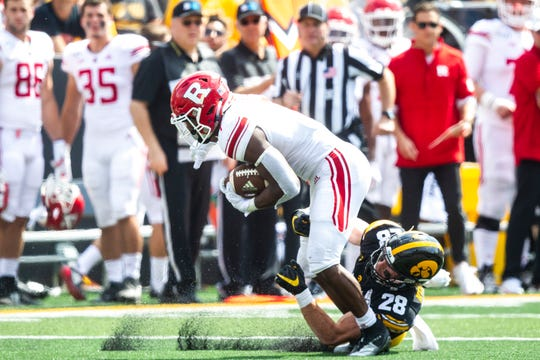 Iowa defensive back Jack Koerner (28) tackles Rutgers running back Isaih Pacheco (1) during a NCAA Big Ten Conference football game against Rutgers, Saturday, Sept. 7, 2019, at Kinnick Stadium in Iowa City, Iowa.