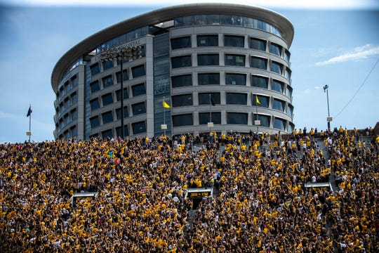 People in the Stead Family Children's hospital wave to fans in the stadium after the first quarter during a NCAA Big Ten Conference football game against Rutgers, Saturday, Sept. 7, 2019, at Kinnick Stadium in Iowa City, Iowa.