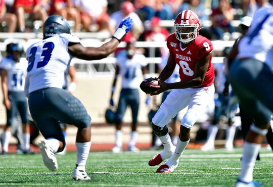 Sep 7, 2019; Bloomington, IN, USA; Indiana Hoosiers quarterback Michael Penix Jr. (9) looks for a teammate during the first quarter of the game against the Eastern Illinois Panthers at Memorial Stadium .