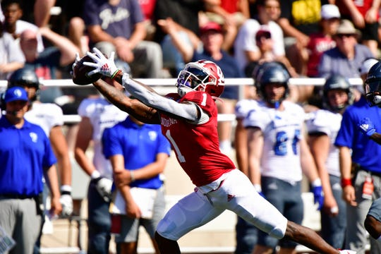 Hoosiers wide receiver Whop Philyor (1) catches a pass during the first quarter of the game against the Eastern Illinois Panthers at Memorial Stadium.