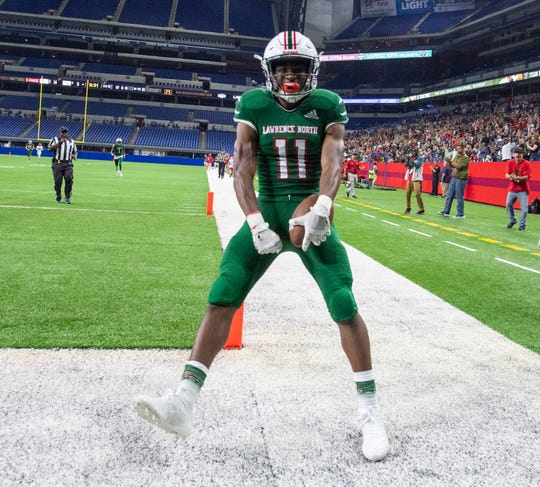 Lawrence North High School sophomore Omar Cooper (11) celebrates scoring a touchdown during the first half of action. Lawrence North and Lawrence Central high schools competed Friday, Sept. 6, 2019 in IHSAA varsity football action at Lucas Oil Stadium in Indianapolis.