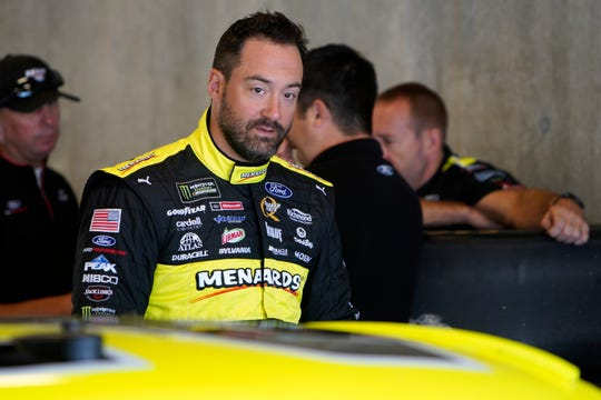 Paul Menard and the Wood Brothers Racing team work Saturday in the garage at the Indianapolis Motor Speedway.