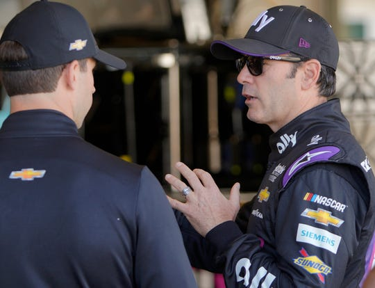 Monster Energy NASCAR Cup Series driver Jimmie Johnson (48) talks with a crew member in the garage at the Indianapolis Motor Speedway, Saturday, Sept. 7, 2019. Drivers were gearing up for the Big Machine Vodka 400 at the Brickyard on Sunday, Sept 8, 2019.