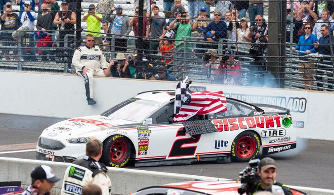 Monster Energy NASCAR Cup Series driver Brad Keselowski (2) celebrates winning the rain-delayed running of the 25th Brickyard 400 at Indianapolis Motor Speedway Monday, Sept. 10, 2018.