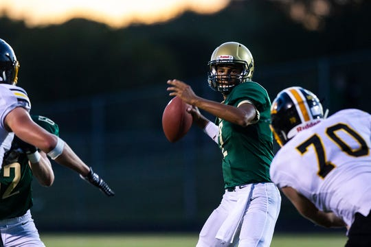 Iowa City West quarterback Marcus Morgan (2) drops back to pass during a Class 4A varsity football game, Friday, Sept. 6, 2019, at Trojan Field in Iowa City, Iowa.