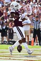 Sep 7, 2019; Starkville, MS, USA; Mississippi State Bulldogs running back Nick Gibson (21) reacts after scoring a touchdown against the Southern Miss Golden Eagles during the second quarter at Davis Wade Stadium. Mandatory Credit: Matt Bush-USA TODAY Sports