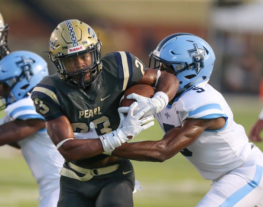 Pearl High School's Kenyatta Harrell (23) is tackled by Ridgeland High School's Yamarus Banks (5). Ridgeland and Pearl played in an MHSAA football game on Friday, September 6, 2019 at Pearl High School. Photo by Keith Warren