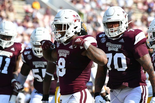 Mississippi State Bulldogs running back Kylin Hill (8) reacts with teammates after scoring a touchdown against the Southern Miss Golden Eagles during the third quarter at Davis Wade Stadium on Sept. 7, 2019 in Starkville, Mississippi.