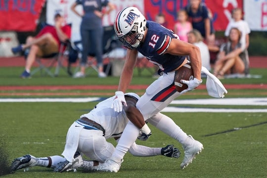 MRA receiver Justin Williams (12) tries to escape the tackle of JA defender Ja'Ree Myers during game action September 6th 2019 in Madison, Mississippi.(Bob Smith/Special to the Clarion Ledger)
