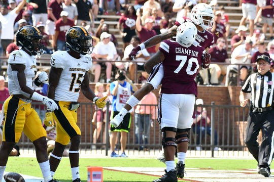 Sep 7, 2019; Starkville, MS, USA; Mississippi State Bulldogs wide receiver Osirus Mitchell (5) reacts with Mississippi State Bulldogs offensive lineman Tommy Champion (70) after a touchdown against the Southern Miss Golden Eagles during the first quarter at Davis Wade Stadium. Mandatory Credit: Matt Bush-USA TODAY Sports