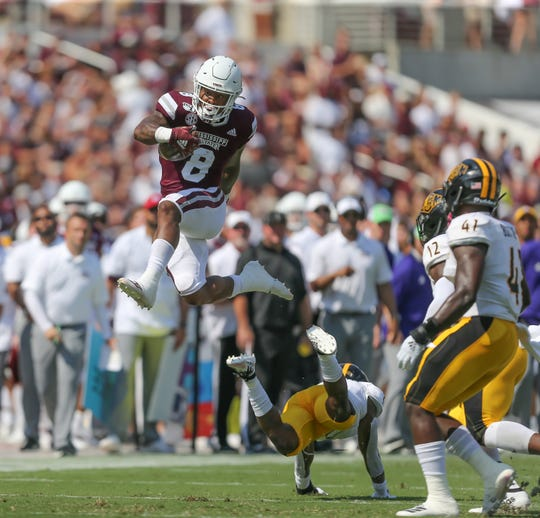 Mississippi State's Kylin Hill (8) goes high in the air to avoid Southern Mississippi's Ty Williams (7). Mississippi State and Southern Mississippi played in a college football game on Saturday, September 7, 2019 at Davis Wade Stadium in Starkville. Photo by Keith Warren