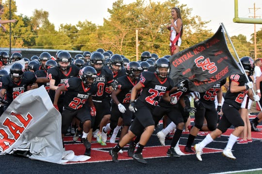 The Central High football team enters the field on Sept. 6, 2019.