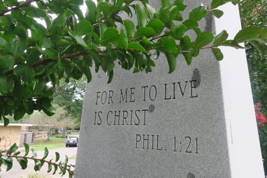 """The Greenwood Cemetery memorial plot of Dr. Bill Wallace inscludes a replica of the obelisk that once graced his original grave in China. The obelisk inspiration """"For Me To LIve in Christ"""" is from the New Testament."""