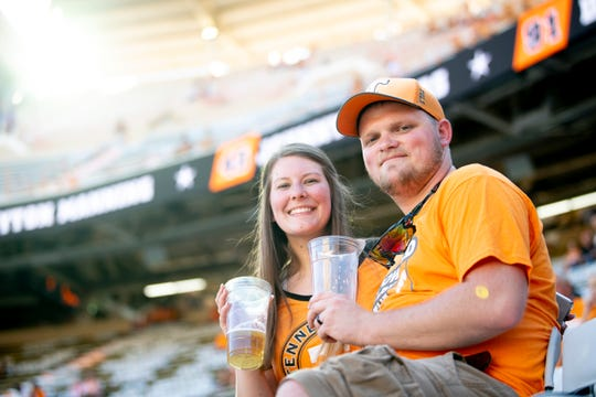 Sean and Chatney Turner, newlyweds on their honeymoon from Indiana, were one of the first people to purchase beer in Neyland Stadium during the BYU on Saturday, September 7, 2019. Saturday was the first time beer was sold at a football game since the SEC changed its alcohol policies earlier this year.