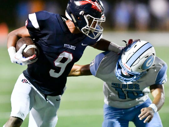 South-Doyle's Santana Curtis (9) is tackled by Gibbs' JA Pittman (10) on Friday, September 6, 2019.