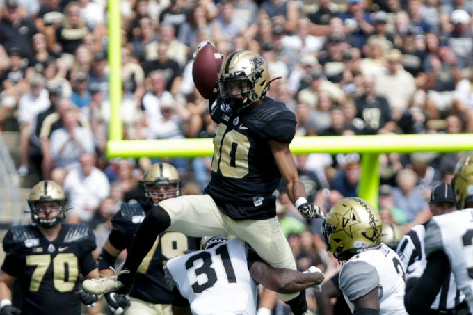 Purdue wide receiver Amad Anderson Jr. (10) leaps unsuccessfully over Vanderbilt defensive back Cam Watkins (31) during the first quarter of a NCAA football game, Saturday, Sept. 7, 2019 at Ross-Ade Stadium in West Lafayette.