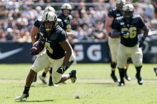 Purdue wide receiver Rondale Moore (4) runs the ball into the end zone to score a touchdown during the second half of a NCAA football game, Saturday, Sept. 7, 2019 at Ross-Ade Stadium in West Lafayette.