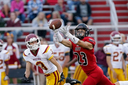 Lafayette Jeff defensive back Garrett Price (23) intercepts a pass intended for McCutcheon wide receiver Spencer Kannal (3) during the second quarter of an IHSAA football game, Friday, Sept. 6, 2019 at Scheumann Stadium in Lafayette. Lafayette Jeff won, 47-12.