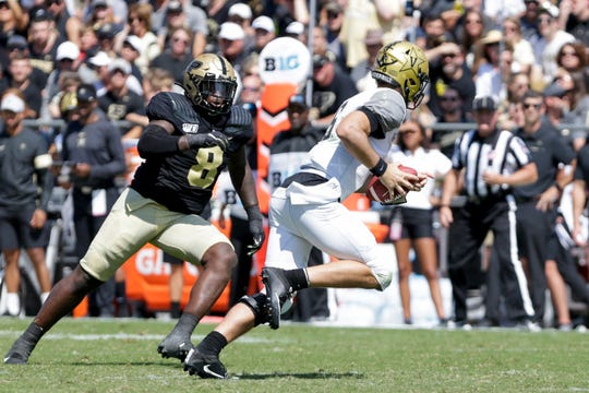 Purdue defensive tackle Anthony Watts (8) chases down Vanderbilt quarterback Riley Neal (6) during the third quarter of a NCAA football game, Saturday, Sept. 7, 2019 at Ross-Ade Stadium in West Lafayette.