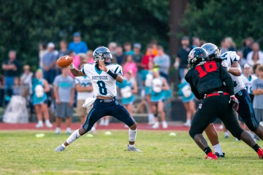Southside High's Dillion Monette throws to an open receiver during the play as the Southside high school Sharks take on the Northside high school Vikings at Northside on September 6, 2019.