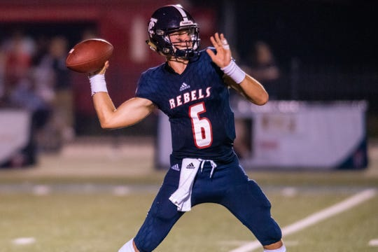 Teurling's quarterback Sammy Leblanc throws a pass during the play as the Teurlings Catholic Rebels take on the Comeaux high Spartans at home on Friday, Sept. 6, 2019.
