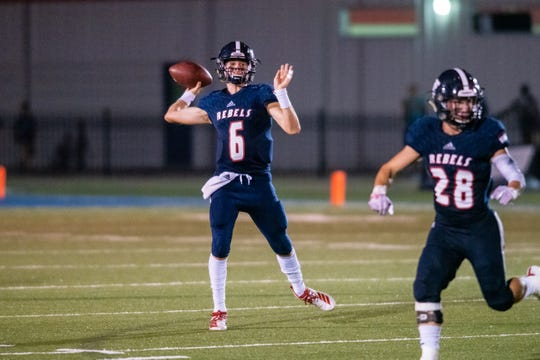 Teurling's Sammy Leblanc throws a pass to a receiver as the Teurlings Catholic Rebels take on the Comeaux high Spartans at home on Friday, Sept. 6, 2019.