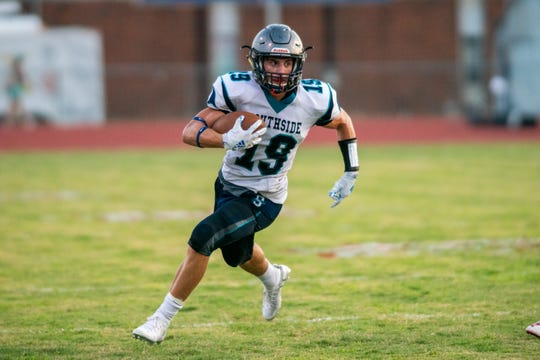 Southside High's Jack Pruitt runs the ball down the field as the Southside high school Sharks take on the Northside high school Vikings at Northside on September 6, 2019.