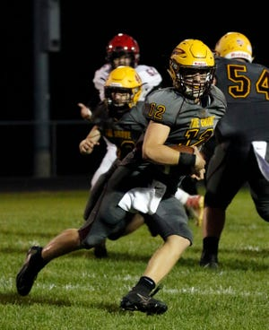 Berne Union quarterback Nate Nemeth runs ball Friday, Sept. 6, 2019, during the Rockets' 33-12 loss to Alexander in Sugar Grove.