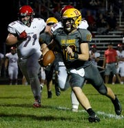 Berne Union freshman quarterback Nate Nemeth runs the ball during a game earlier this season against Alexander. The Rockets are currently on a three-game winning streak and improved their record to 4-3.