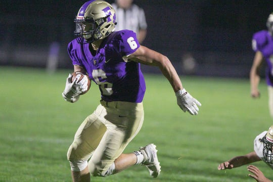 Fowlerville's Hunter Knaggs runs in the first of the Gladiators' three touchdowns, shutting out Corunna at home Friday, Sept. 6, 2019.