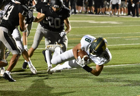 Avry McInroy scores Howell's only touchdown in a 38-7 loss at Plymouth on Friday, Sept. 6, 2019.