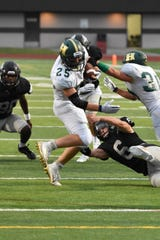Howell's Jonah Schrock battles for yardage in a 38-7 loss at Plymouth on Friday, Sept. 6, 2019.
