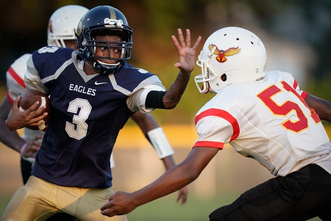 Shawnee High School quarterback Jacky Woodard runs with the ball during the football game played against Seneca in Louisville, Ky., Saturday, September 6, 2019.